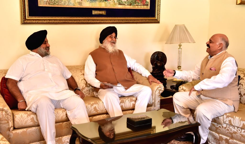 :Chandigarh: Punjab Chief Minister  Parkash Singh Badal along with Deputy Chief Minister Sukhbir Singh Badal during a meeting with the Punjab Governor V.P. Singh Badnore to hand over a letter ...
