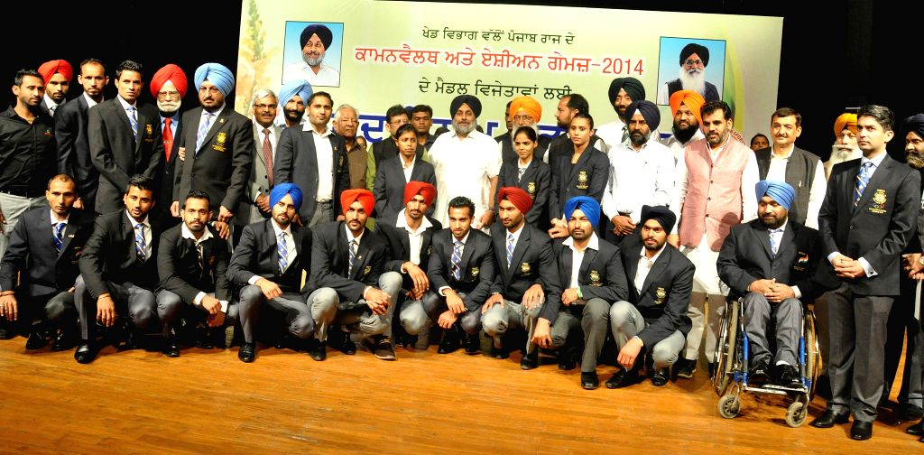Punjab Deputy Chief Minister Sukhbir Singh Badal with the Asian and Commonwealth medal winners during an award ceremony in Chandigarh on Nov 11, 2014. - Sukhbir Singh Badal