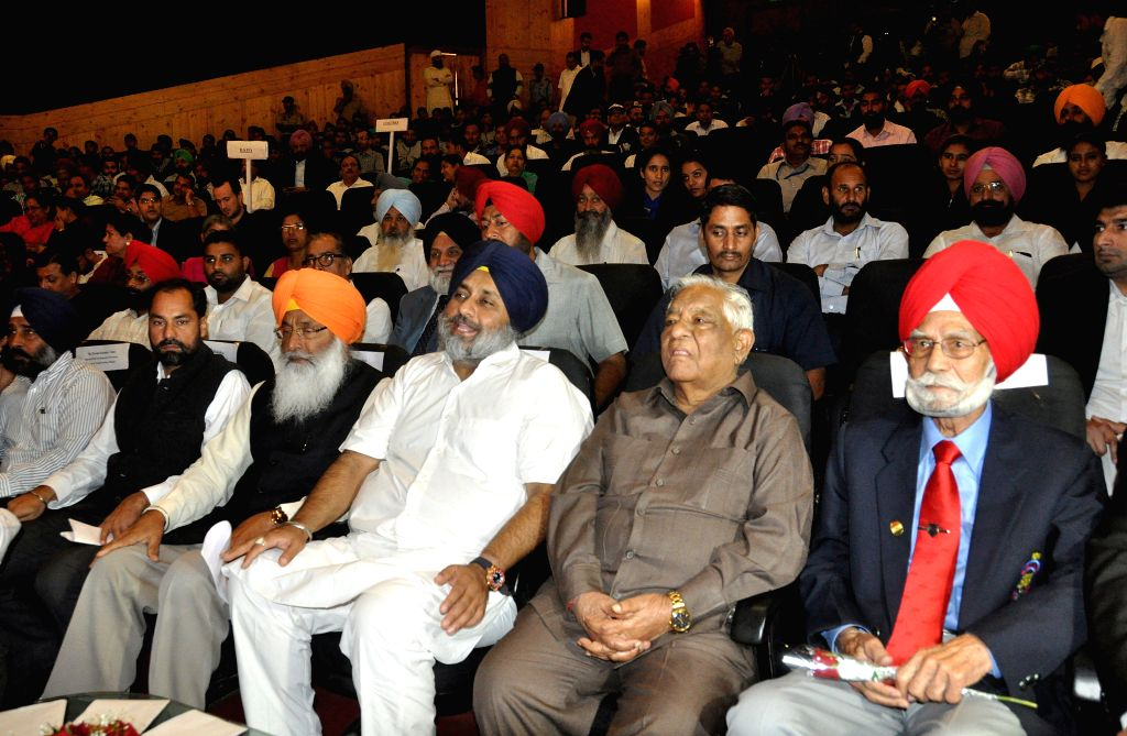 Punjab Deputy Chief Minister Sukhbir Singh Badal and others during Asian and Commonwealth medal winners award ceremony in Chandigarh on Nov 11, 2014. - Sukhbir Singh Badal
