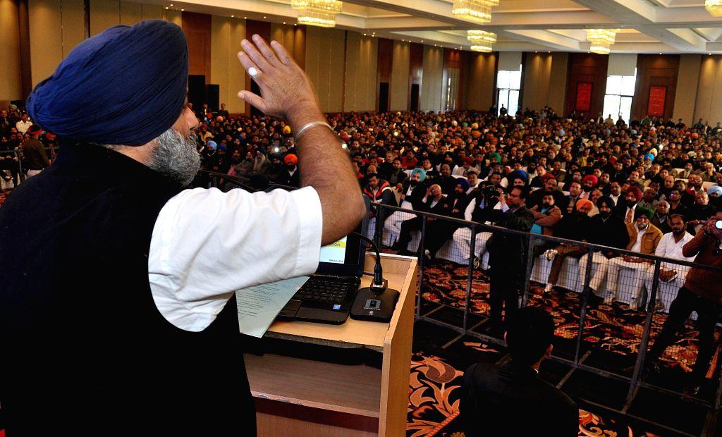 Punjab Deputy Chief Minister Sukhbir Singh Badal addressing traders at Zirakpur (SAS Nagar) in Chandigarh on Jan. 30, 2015. - Sukhbir Singh Badal