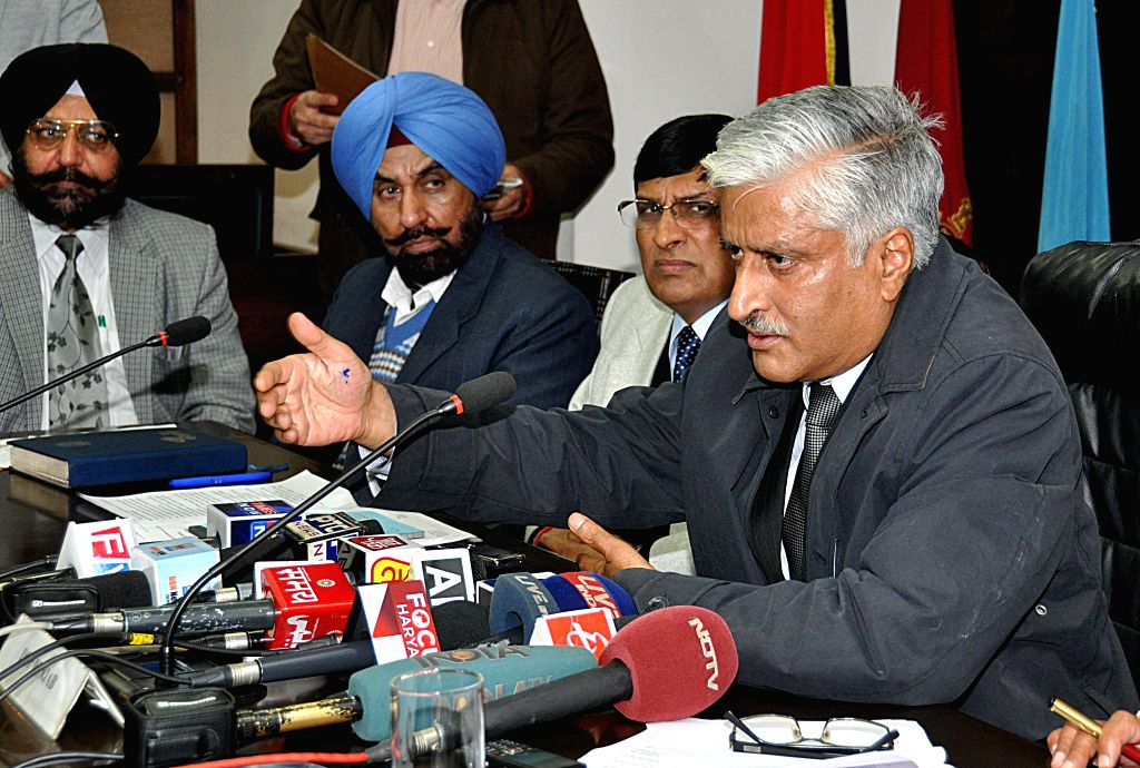 Punjab DGP Sumedh Singh Saini addresses during a press conference in Chandigarh on Jan. 7, 2014. - Sumedh Singh Saini