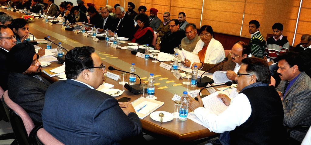 The chairman of National SC Commission P.L Punia during a meeting with Vice Chairman National Commission for Schedule Caste (NCSC) Raj Kumar Verka  in Chandigarh, on Jan 20, 2015. - Kumar Verka