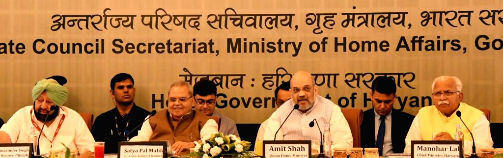 Chandigarh: Union Home Minister Amit Shah presides over the 29th Meeting of the Northern Zonal Council in Chandigarh, on Sep 20, 2019. Also seen Punjab Chief Minister Amarinder Singh, J&K Governor Satya Pal Malik and Haryana Chief Minister Manohar La - Amit Shah, Malik, Amarinder Singh and Manohar Lal Khattar
