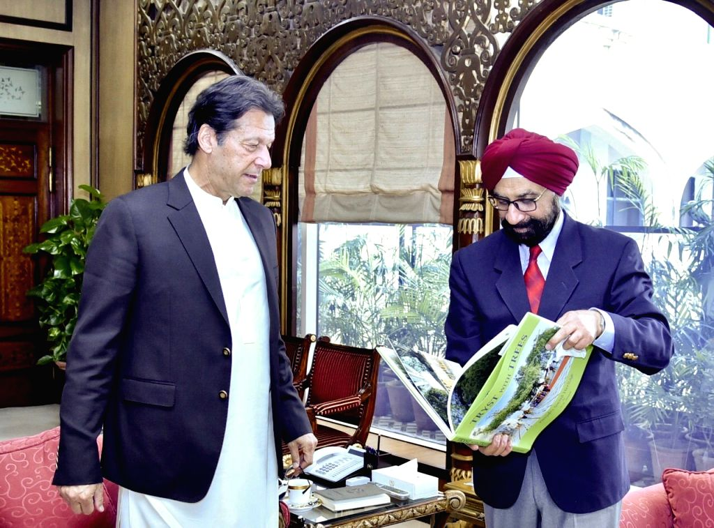 Chandigarh: Writer and former Punjab civil servant D.S. Jaspal calls on Pakistan Prime Minister Imran Khan who hailed his proposal for participation of devotees in sapling plantation in the historic shrine Kartarpur Sahib that was linked with India t - Imran Khan