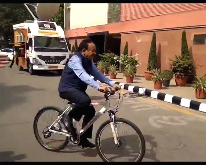 Chandni Chowk BJP MP Harsh Vardhan arrives on a bicycle to take charge as the Union Minister for Health and Family Welfare to mark the World Bicycle Day, at Nirman Bhawan in New Delhi on ...
