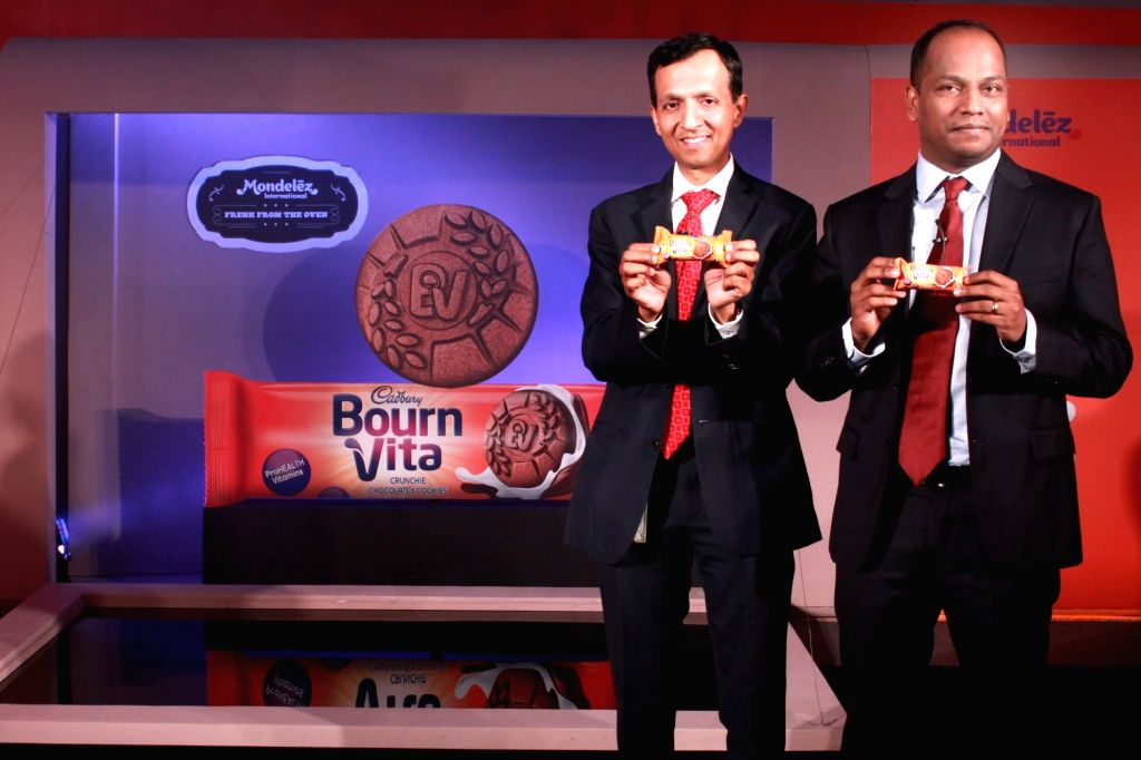 "Chandramouli Venkatesan and Chella Pandyan of Mondelez India at the launch of their new biscuit brand, ""Cadbury Bournvita""  in New Delhi on April 19, 2016."