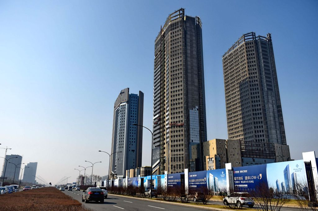 CHANGCHUN, April 18, 2016 - Photo taken on April 18, 2016 shows residential buildings under construction in Changchun City,  northeast China's Jilin Province. China's property market continued to ...
