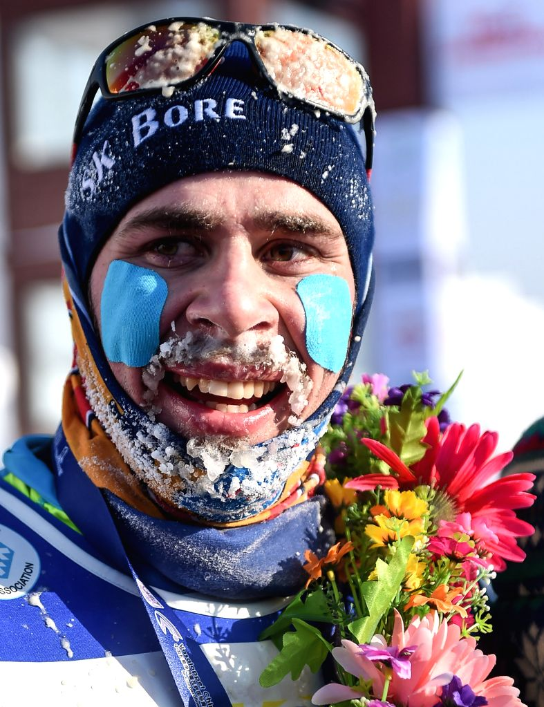 Sweden's Bob Niemi-Impola celebrates after the men's 50km classic in FIS cross-country skiing race in Changchun, capital of northeast China's Jilin Province, Jan. .