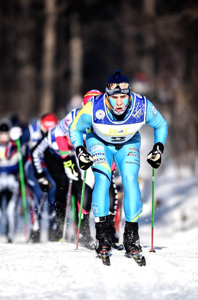 Sweden's Bob Niemi-Impola (front) competes during the men's 50km classic in FIS cross-country skiing race in Changchun, capital of northeast China's Jilin ...