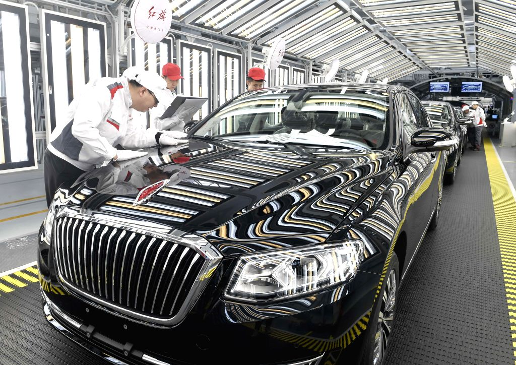 CHANGCHUN, June 25, 2019 (Xinhua) -- Staff members check on a Hongqi vehicle at a plant of China's First Automobile Workshop (FAW) in Changchun, northeast China's Jilin Province, April 9, 2019. China's leading automaker FAW Group has made a dent in a