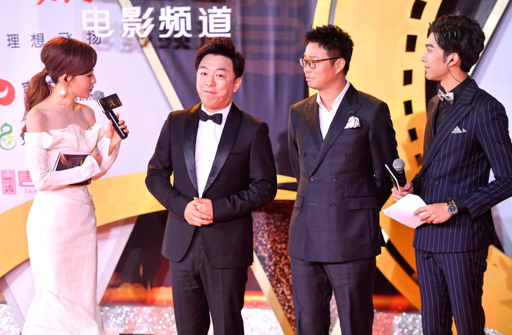 CHANGCHUN, Sept. 8, 2018 - Actor Huang Bo (2nd L) and Wang Xun (3rd L) are seen on the red carpet as they arrive for the closing ceremony of the 14th Changchun Film Festival in Changchun, northeast ... - Huang B