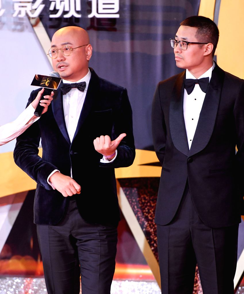 """CHANGCHUN, Sept. 8, 2018 - Actor Xu Zheng (L) and director Wen Muye for """"Dying to Survive"""" are seen on the red carpet as they arrive for the closing ceremony of the 14th Changchun Film ... - X"""