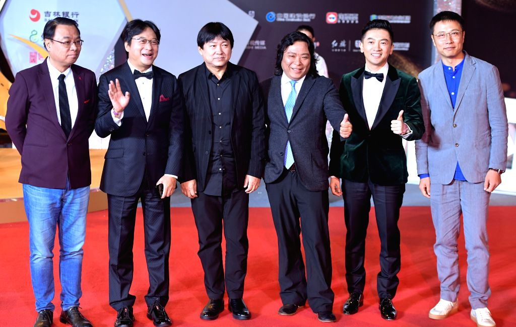 CHANGCHUN, Sept. 8, 2018 - Some jury members pose on the red carpet as they arrive for the closing ceremony of the 14th Changchun Film Festival in Changchun, northeast China's Jilin Province, Sept. ...