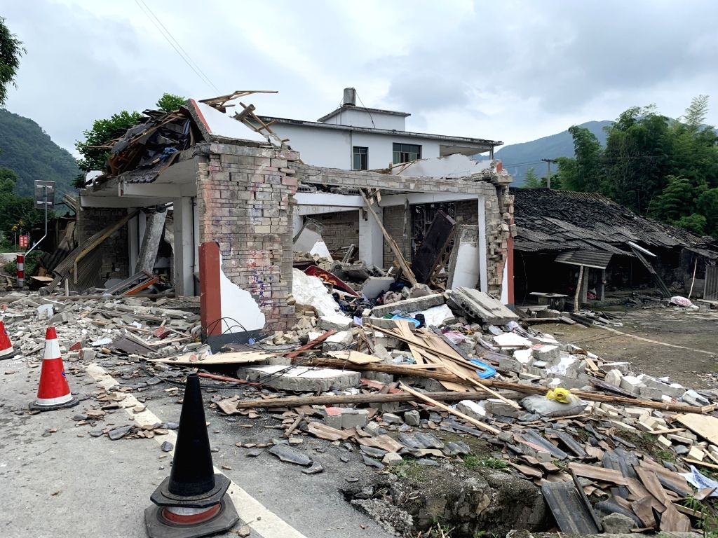 CHANGNING, June 18, 2019 - Photo taken on June 18, 2019 shows collapsed houses at Putao Village in Shuanghe Town, Changning County of Yibin City, southwest China's Sichuan Province. Twelve people ...