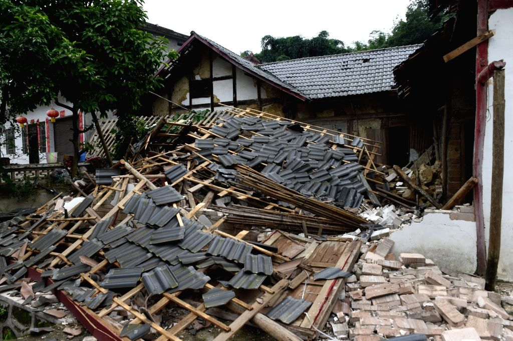 CHANGNING, June 18, 2019 - Photo taken on June 18, 2019 shows collapsed houses at Shuanghe Town in Changning County of Yibin City, southwest China's Sichuan Province. Twelve people died and another ...