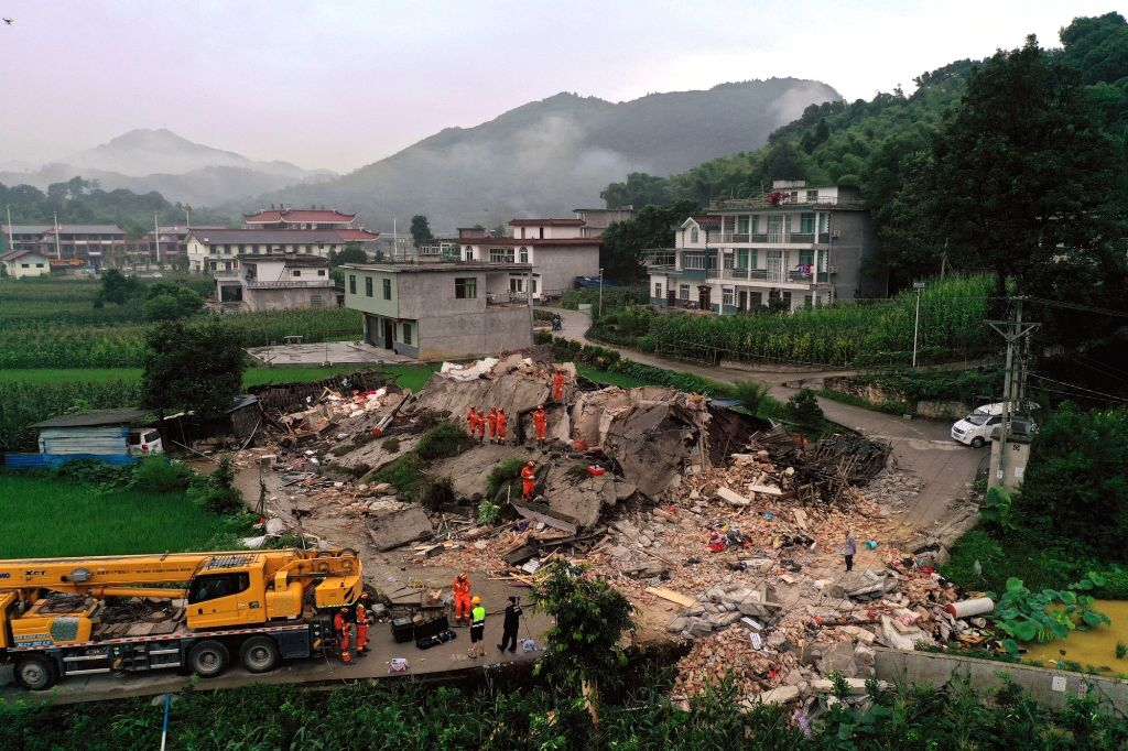 CHANGNING, June 18, 2019 - Rescuers search for trapped people in Shuanghe Town in Changning County of Yibin City, southwest China's Sichuan Province, June 18, 2019. Eleven people died and another 122 ...