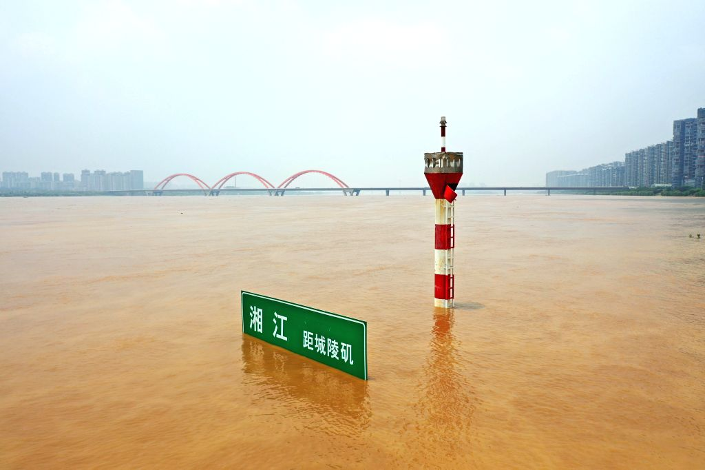 CHANGSHA, July 10, 2019 (Xinhua) -- Aerial photo taken on July 10, 2019 shows a submerged navigation sign in the flooded Xiangjiang River in Changsha, central China's Hunan Province. The water level of Xiangjiang River is above warning line due to co