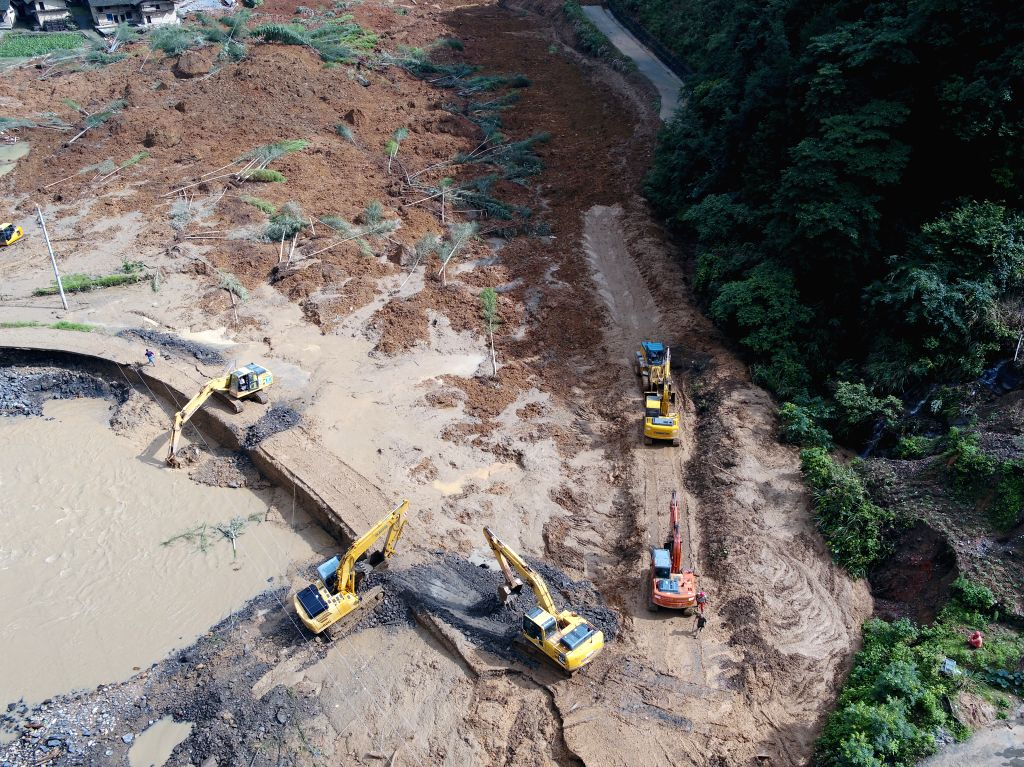 CHANGSHA, July 2, 2017 - Rescuers and dredging machines work at the site of a landslide in Zuta Village of Ningxiang County, central China's Hunan Province. A mudslide in Zuta Village of Ningxiang ...