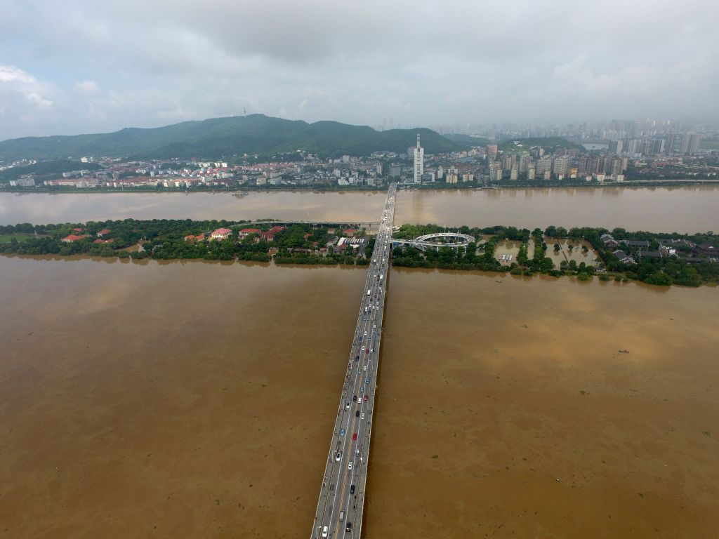 CHANGSHA, July 2, 2017 - The Juzizhou Islet is flooded in the Xiangjiang River in Changsha, capital of central China's Hunan Province, July 2, 2017. Heavy rainfall caused the river's water level to ...