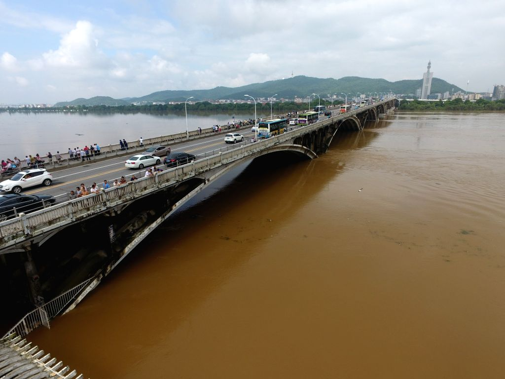 CHANGSHA, July 2, 2017 - The piers of the Juzizhou Bridge across the Xiangjiang River are submerged in Changsha, capital of central China's Hunan Province, July 2, 2017. Heavy rainfall caused the ...