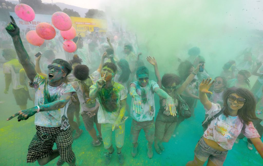 Participants take part in a color run in Changsha, central China's Hunan Province, June 18, 2014.
