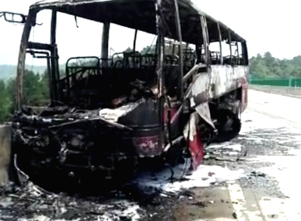 CHANGSHA, June 26, 2016 - Photo provided by witness on June 26, 2016 shows the accident site of a bus fire in Yizhang County, central China's Hunan Province. Casualties have been reported after a ...