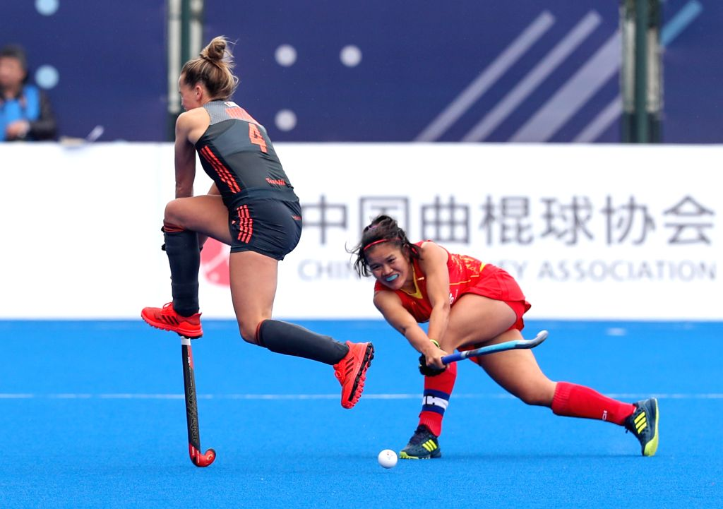 CHANGZHOU, March 3, 2019 - Lieke Hulsen (L) of the Netherlands vies with Zhang Jinrong of China during the 2019 FIH PRO LEAGUE women's league hockey match in Changzhou, east China's Jiangsu Province, ...