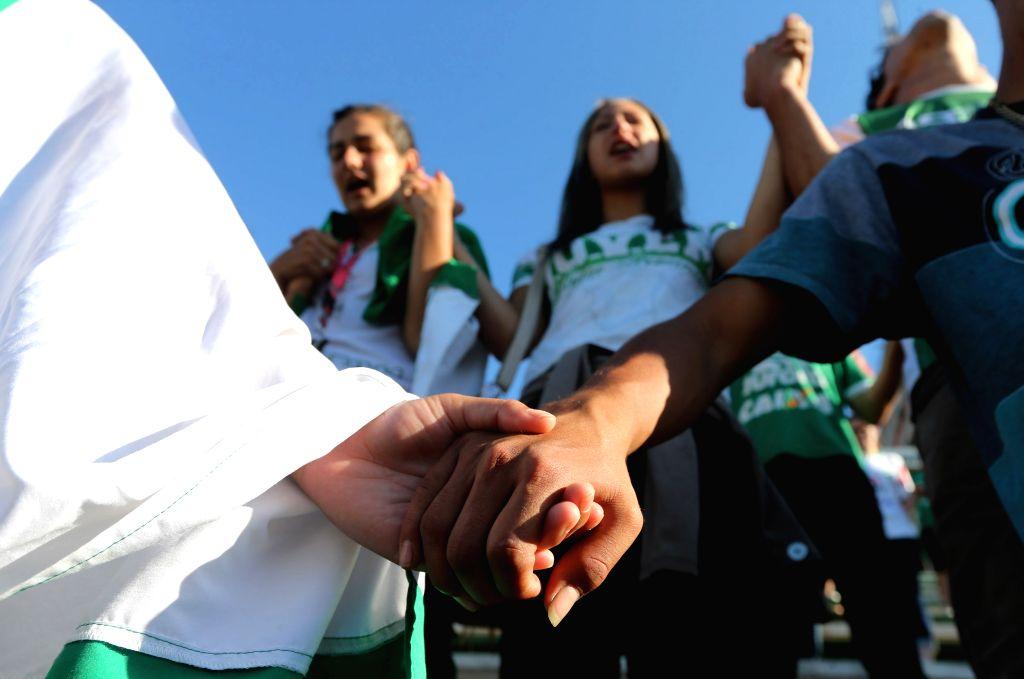CHAPECO, Nov. 30, 2016 - Supporters of Brazilian football team Chapecoense take part in a vigil at Conda Arena in Chapeco municipality, Santa Catarina state, Brazil, on Nov. 29, 2016. Colombian ...