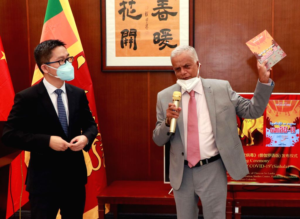 Charge d'affaires of the Chinese embassy in Sri Lanka Hu Wei (L) and Pathfinder Foundation Executive Director Lakshman Siriwardana attend a launch ceremony of the ...