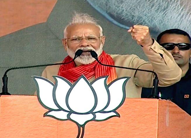 Charkhi Dadri: Prime Minister Narendra Modi addresses a public meeting in Charkhi Dadri, Haryana on Oct 15, 2019. (Photo: IANS) - Narendra Modi