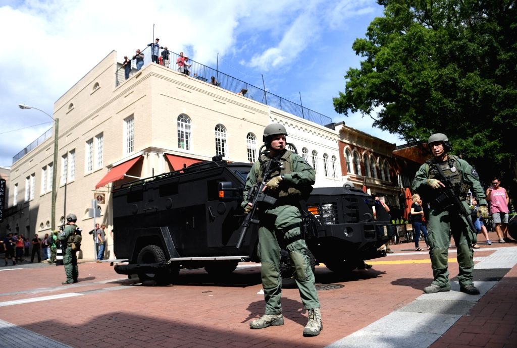 CHARLOTTESVILLE (U.S.), Aug. 12, 2017 (Xinhua) -- Police stand guard near the rally site in Charlottesville, Virginia, the United States, Aug. 12, 2017. At least one person was killed in a multiple car crash following a violent white nationalist rall