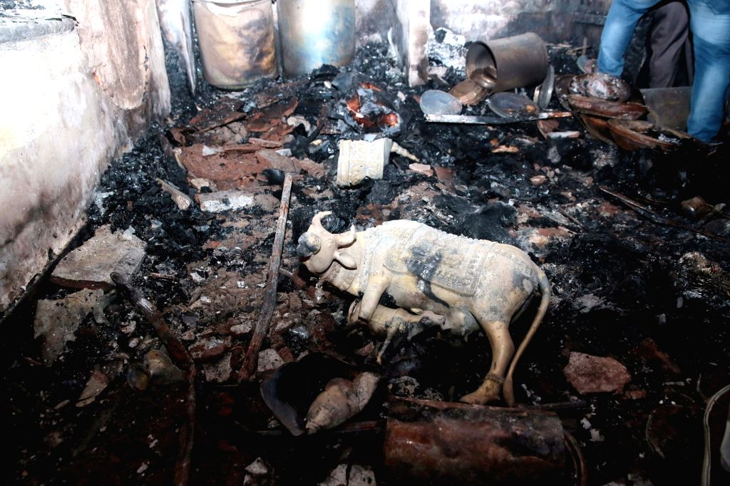 Charred remains inside the residence of Congress MLA Akanda Srinivas Murthy after an irate mob set his property on fire during violence that erupted overnight on Tuesday in Devara ...