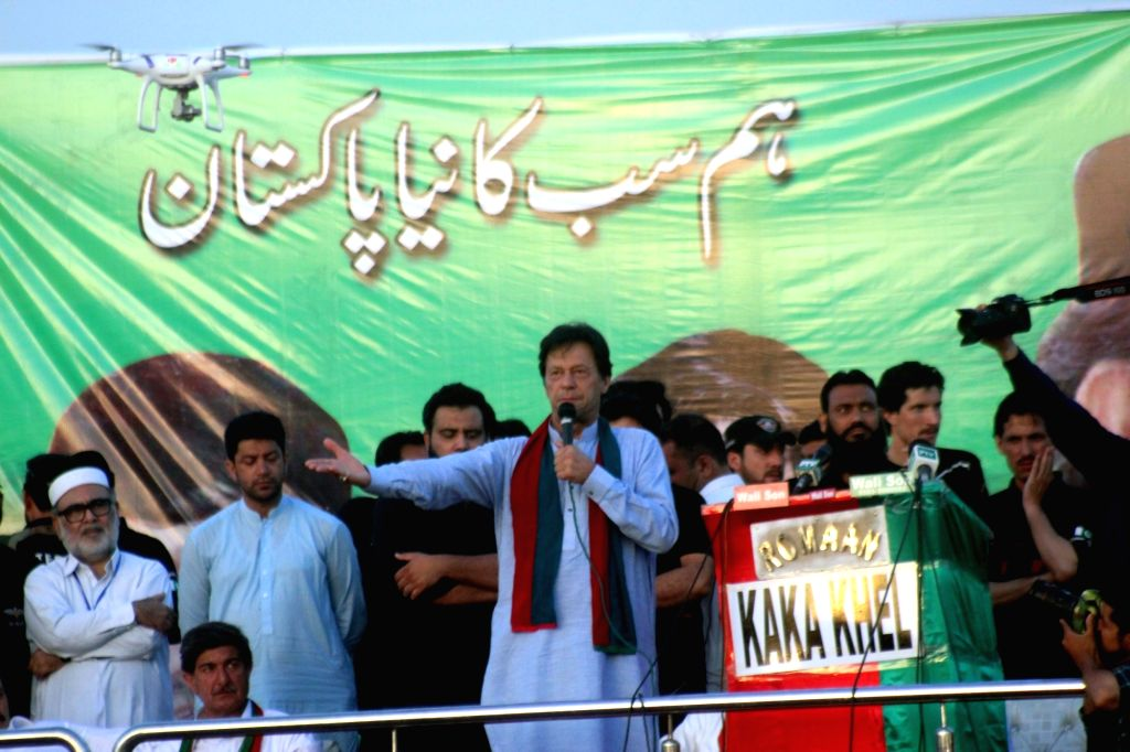 CHARSADDA (PAKISTAN), July 5, 2018 Pakistani cricketer-turned politician and head of the Pakistan Tehreek-i-Insaf (PTI) Imran Khan (C, front) speaks during an election campaign rally in ... - Imran Khan