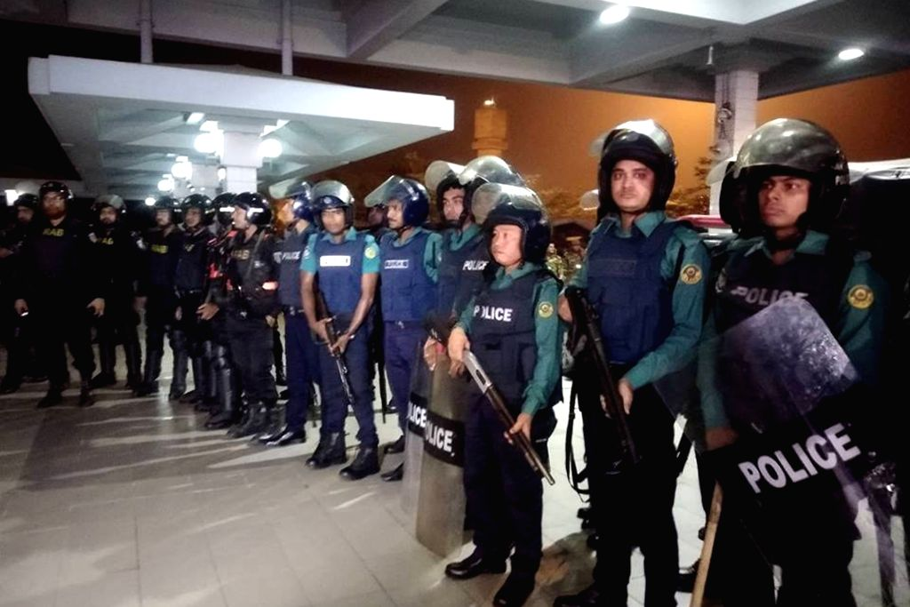 CHATTOGRAM (BANGLADESH), Feb. 24, 2019 Police officers stand guard at the Shah Amanat International Airport in Chattogram, Bangladesh, on Feb. 24, 2019. Bangladeshi commandos stormed a ...