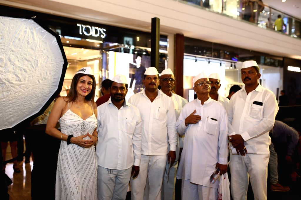 """Chef Anaida Parvaneh with fellow Dabbawalas during the launch of the comic book """"Dabbawala"""" penned and illustrated by artist Abhijeet Kini at a mega-function held at restaurant ... - Abhijeet Kini"""