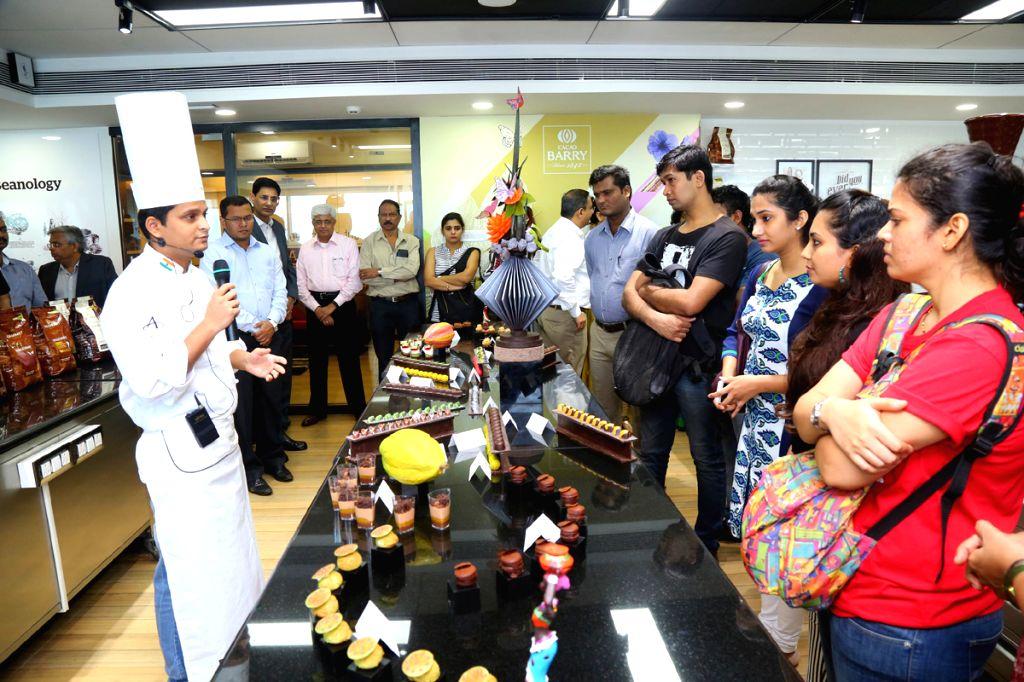 Chef Manikandan speaks at the opening of the relocated Callebaut Chocolate Academy in Mumbai