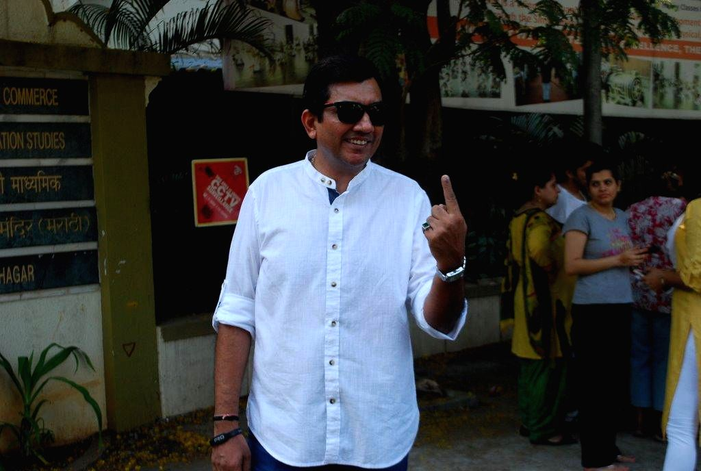 Chef Sanjeev Kapoor shows his fore finger marked with phosphorous ink after casting his vote at a polling booth during the sixth phase of 2014 Lok Sabha Polls in Mumbai on April 24, 2014.