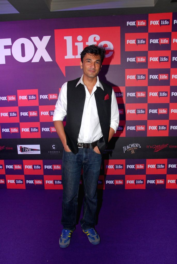Chef Vikas Khanna during the launch of Fox Traveller`s new television channel Fox Life in Mumbai on July 16, 2014. - Vikas Khanna