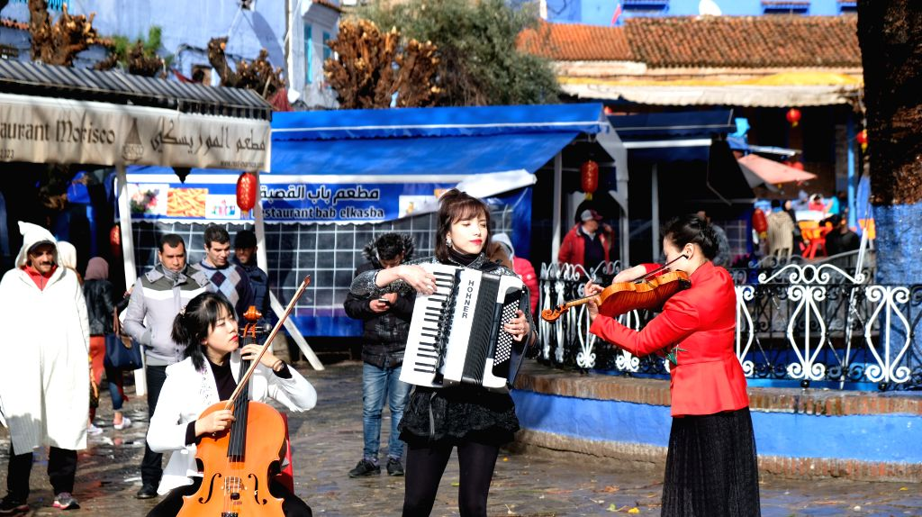 CHEFCHAOUEN, Feb. 2, 2019 - Artists from China's Chongqing present a flash mob show to celebrate the forthcoming Chinese Spring Festival in Chefchaouen, Morocco, Feb. 1, 2019. The Spring Festival ...