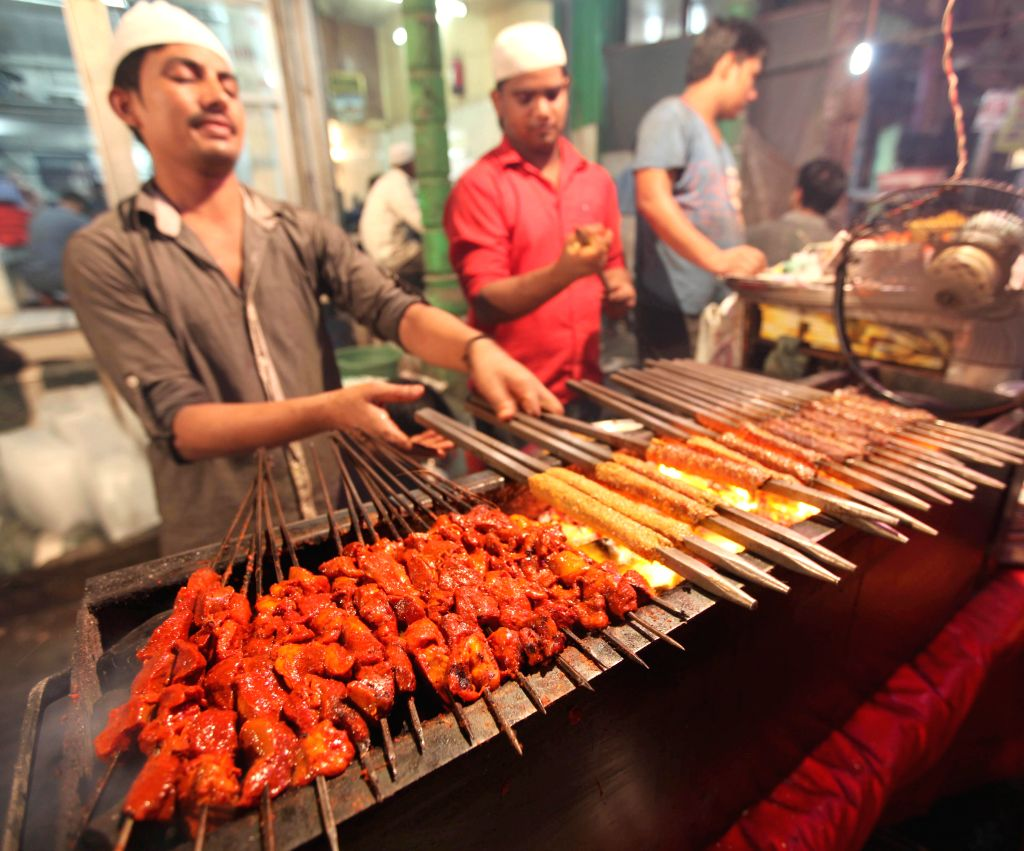 Chefs busy cooking kebabs and other delicacies on the Delhi streets during Ramadan on July 27, 2014.