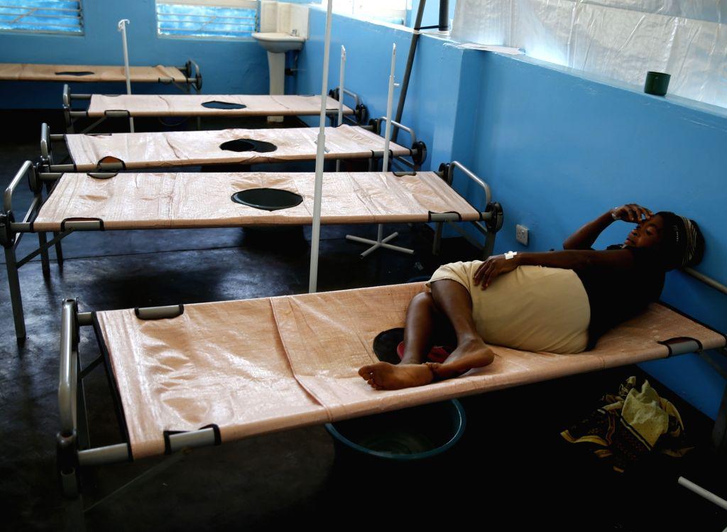 CHEGUTU (ZIMBABWE), Jan. 22, 2018 A patient rests on a bed at a cholera command center at Chinengundu Clinic in Chegutu town, 100 km west of Harare, capital of Zimbabwe, on Jan. 22, 2018. ... - David Parirenyatwa