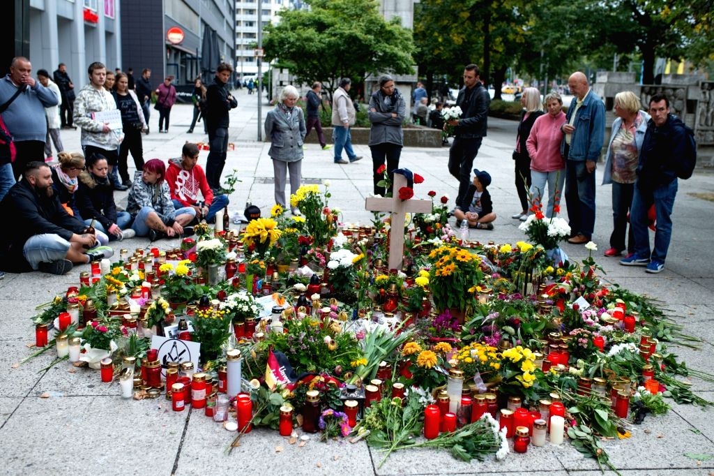 CHEMNITZ, Sept. 2, 2018 - People mourn the victim of the Aug. 25 attack in Chemnitz, eastern Germany, on Sept. 1, 2018. Around 8,000 people took to the streets in German city Chemnitz on Saturday, ...