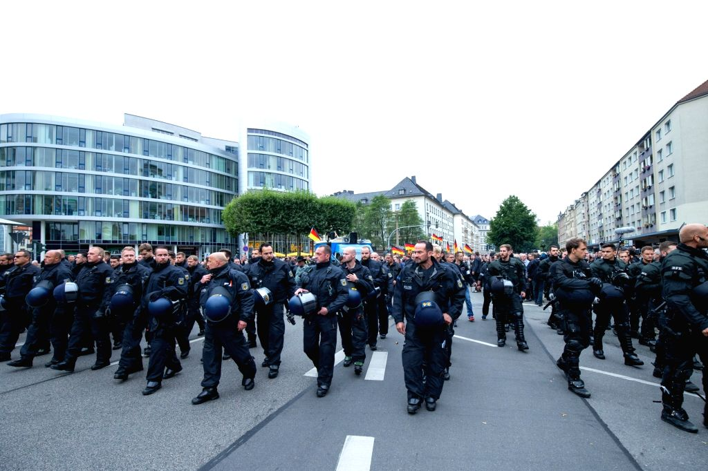 CHEMNITZ, Sept. 2, 2018 - Policemen guard the site of a demonstration in Chemnitz, eastern Germany, on Sept. 1, 2018. Around 8,000 people took to the streets in German city Chemnitz on Saturday, ...