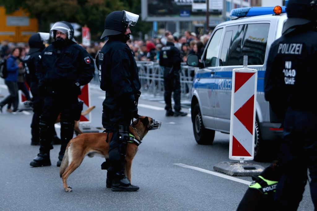 CHEMNITZ, Sept. 2, 2018 - Policemen guard the site of demonstration in Chemnitz, eastern Germany, on Sept. 1, 2018. Around 8,000 people took to the streets in German city Chemnitz on Saturday, ...