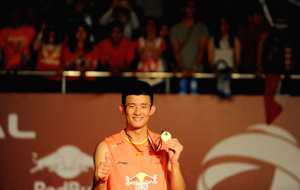 Chen Long of China poses with the medal during the awarding ceremony of the men's singles final match against Lee Chong Wei of Malaysia at the BWF World ...