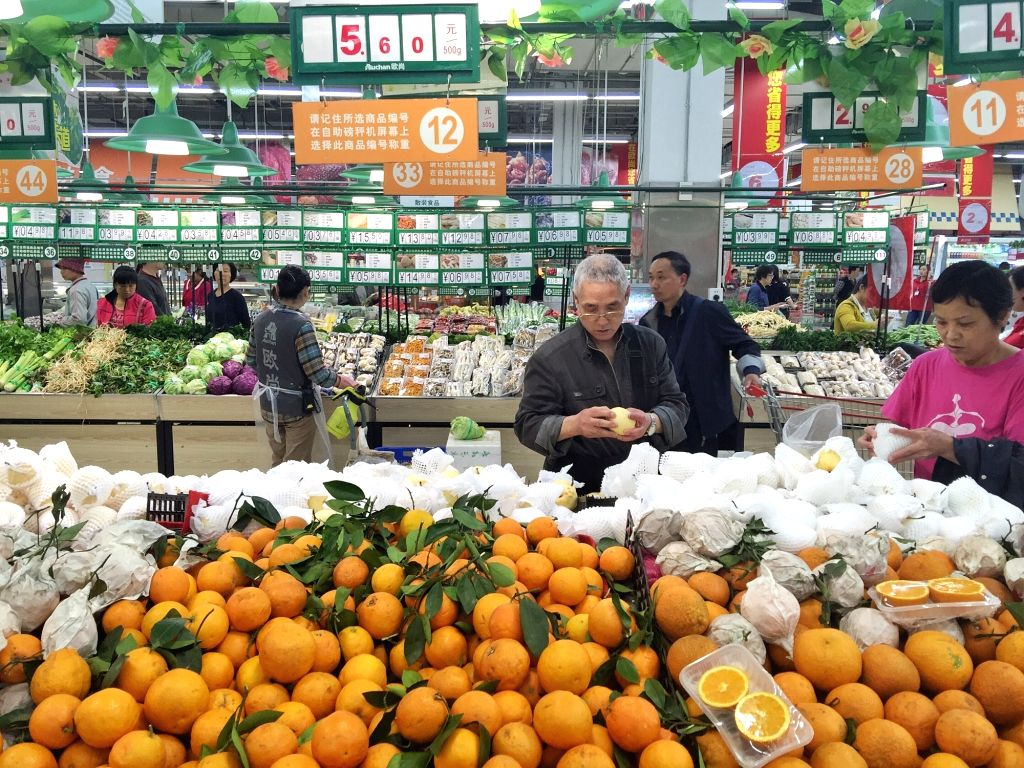 CHENGDU, April 15, 2016 - People buy fruits at a supermarket in Chengdu, capital of southwest China's Sichuan Province, April 11, 2016. China's GDP stood at 15.9 trillion RMB yuan (2.4 trillion U.S. ...