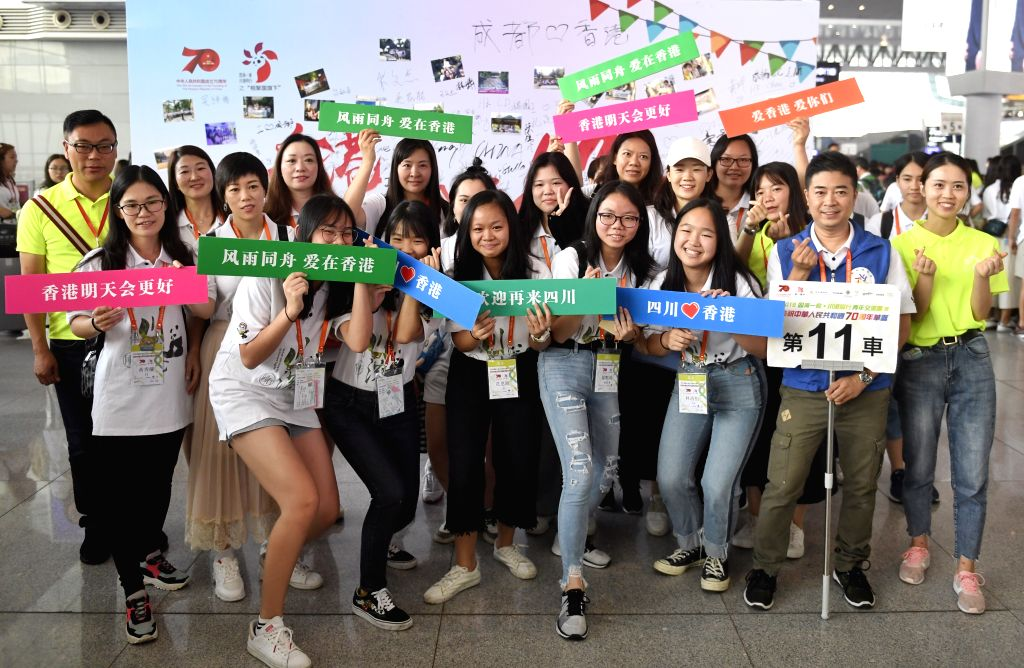 CHENGDU, Aug. 26, 2019 - Young people from Hong Kong and volunteers pose for a group photo at Chengdu East Railway Station in Chengdu, southwest China's Sichuan Province, Aug. 26, 2019. Young people ...