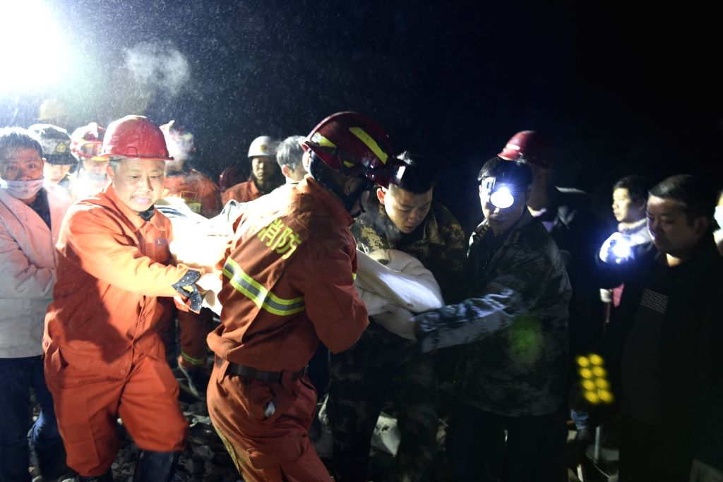 CHENGDU, Dec. 10, 2018 - A survivor is found at the site of landslide in Fenshui Town of Xuyong County, southwest China's Sichuan Province, Dec. 9, 2018. The landslide hit Fenshui Town Sunday ...
