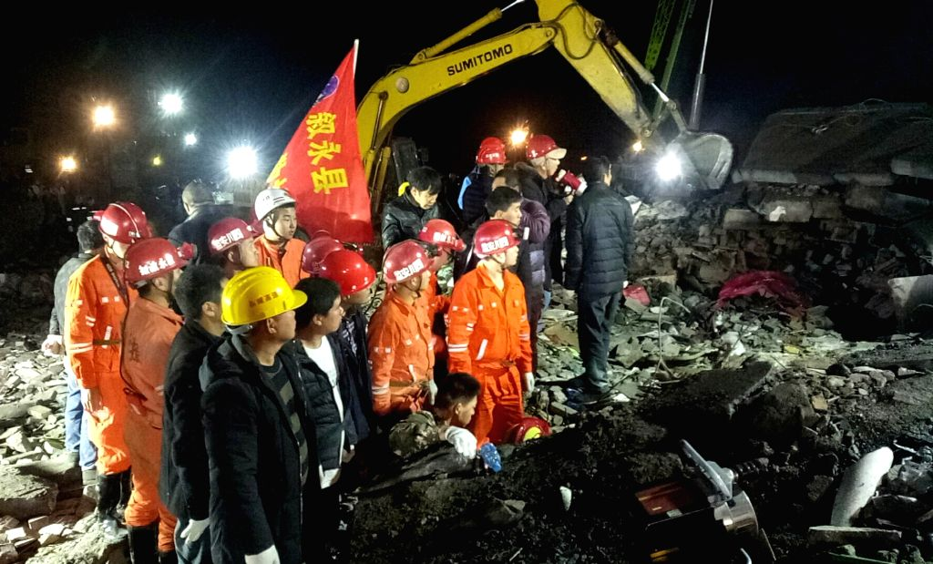 CHENGDU, Dec. 10, 2018 - Rescuers search for survivors at the site where a landslide occurred in Fenshui Township in Xuyong County, southwest China's Sichuan Province, Dec. 9, 2018. Twelve people ...