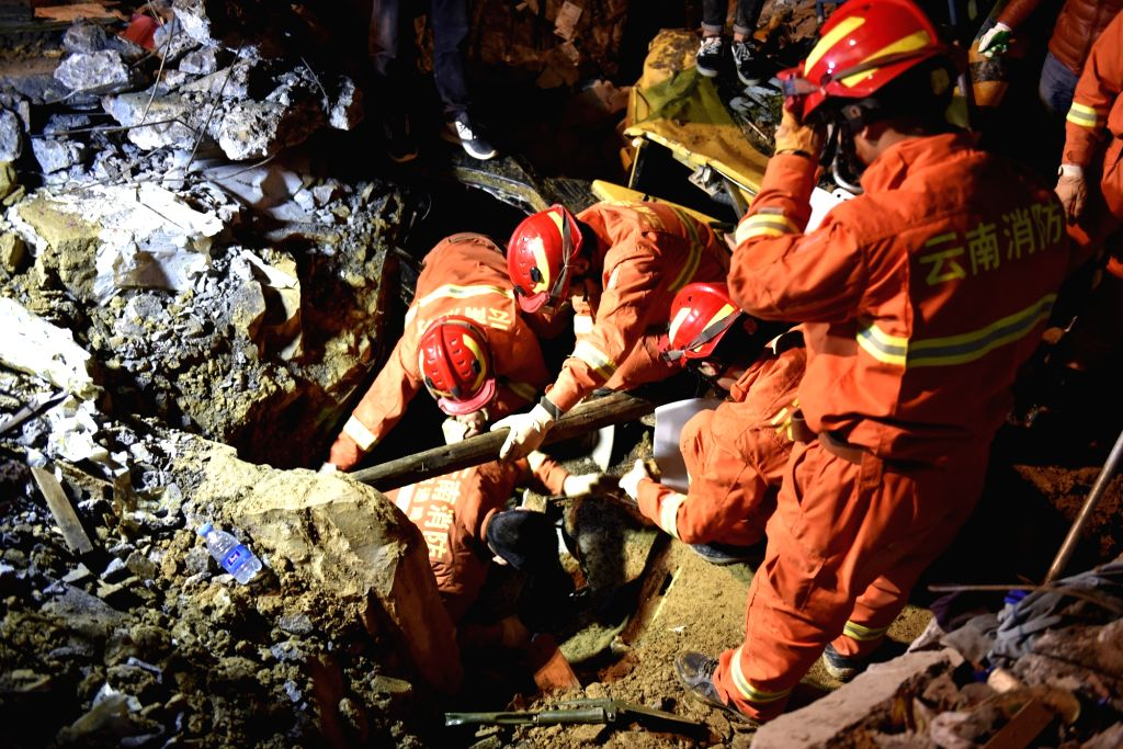 CHENGDU, Dec. 10, 2018 - Rescuers work at the site of landslide in Fenshui Town of Xuyong County, southwest China's Sichuan Province, Dec. 9, 2018. The landslide hit Fenshui Town Sunday afternoon, ...